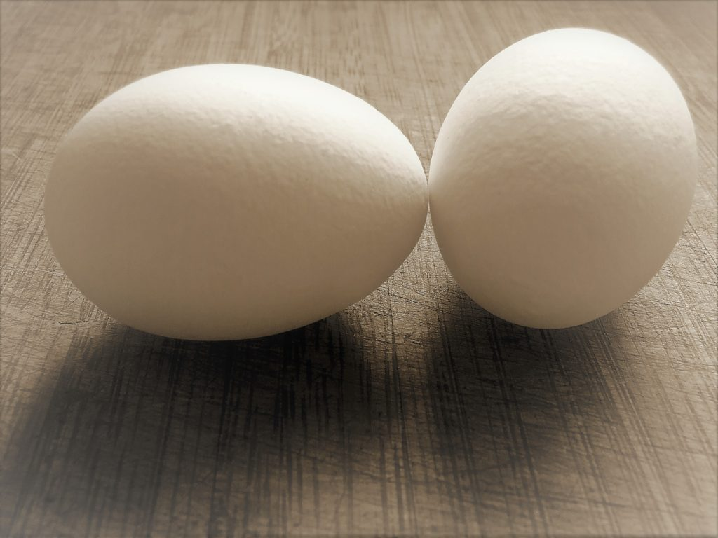 two eggs sitting on a table